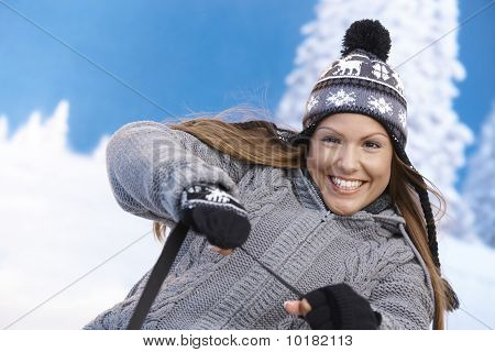 Young Female Having Winter Fun Smiling