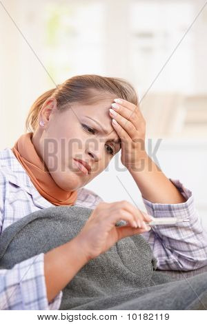 Young Woman Feeling Bad Taking Her Temperature