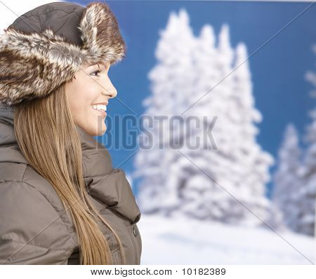 Young Woman Front Of Winter Landscape Smiling