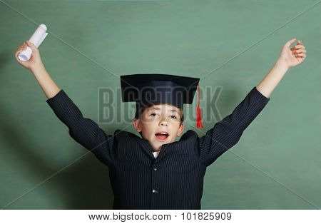 Boy In Business Suit And Graduation Cap Cheer