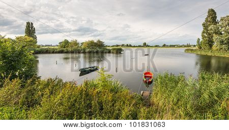 Two Small Boats Moored At The Bank Of The River