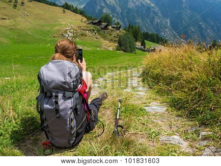 Hiker taking pictures.