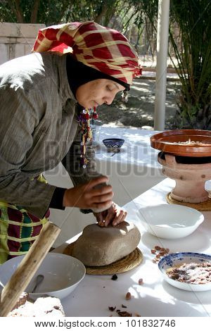 Berber woman makes Argan Oil, Morocco
