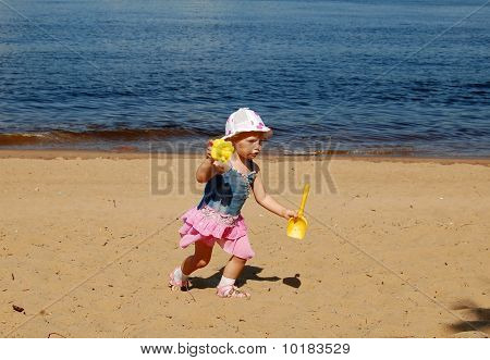 Baby Girl Runing On The Beach