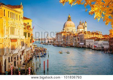 Grand Canal and Basilica Santa Maria della Salute illuminated by evening sun