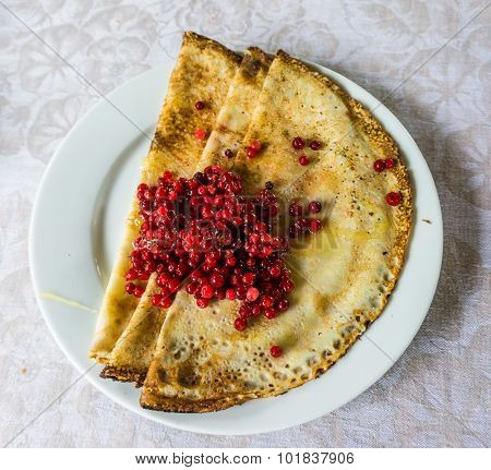 Blini with lingonberries