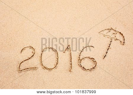Inscription Of The Year 2016 Written In The Wet Yellow Beach Sand