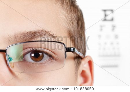 Child An Ophthalmologist .portrait Of A Boy With Glasses.