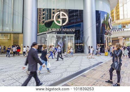 Communters Or Shoppers Walking Pass The Giorgio Armani Store