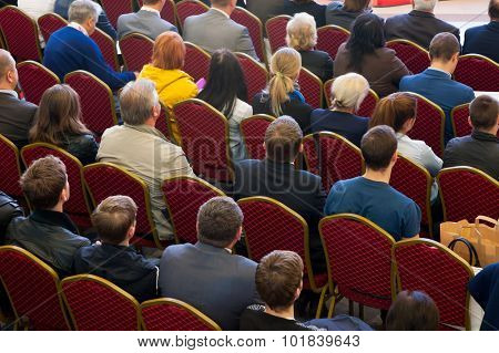 Audience at the conference hall. No recognizable faces