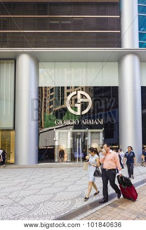 Tourists Walking Pass The Giorgio Armani Store