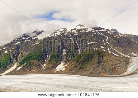 Snow Capped Moutain Above An Alpine Glacier