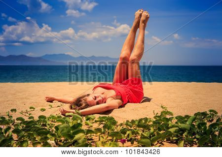 Upper View Girl In Red Lies On Sand Lifts Naked Legs By Creepers