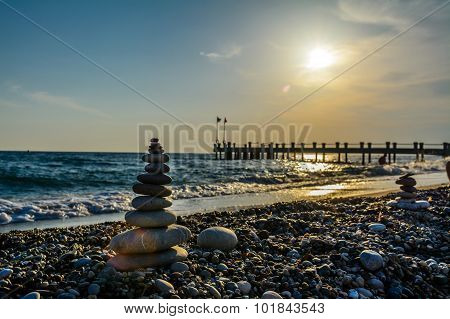 Turret Pebbles With  Sunset Background And A Bridge