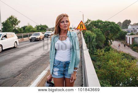 yong beautiful woman walking along bridge