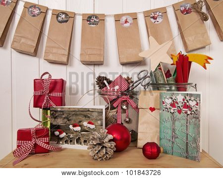 Handmade christmas presents and advent calendar in red, white and green colors in country style.