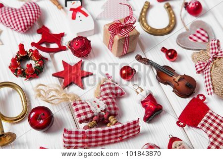 Collection of red and white checkered christmas decoration on wooden background.