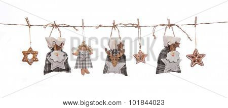 Isolated grey, white and orange isolated hanging christmas decoration with gifts, stars and angels.