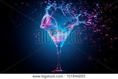 Blue cocktail with splashing water on the black background. Party club entertainment. Mixed light