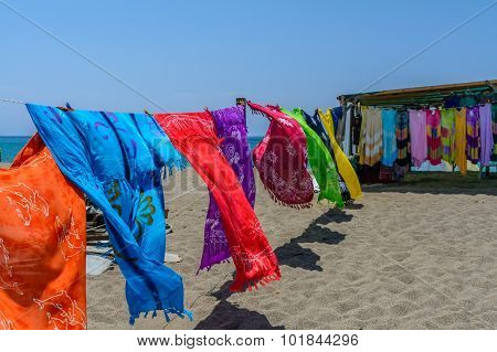 Dust-blown Colorful Scarves On The Beach In A Sunny Summer Day