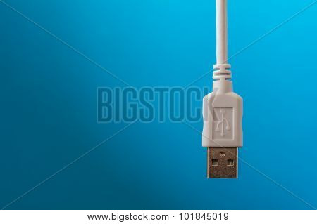 Usb Connection Cable Was Placed In White On A Blue Background