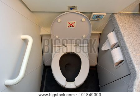 Aircraft lavatory toilets aboard a jetliner airplane.