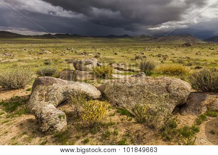 Dramatic Landscape With Rain Clouds Over The Valley And Mountains.