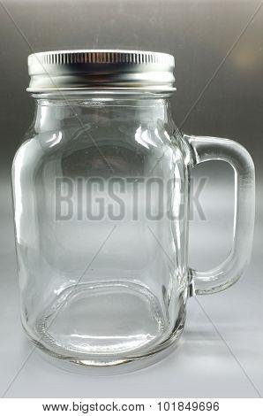 Glass mug with metal lid
