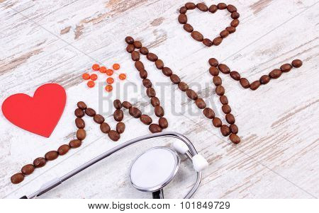 Cardiogram Line Of Coffee Grains, Stethoscope And Supplement Pills, Medicine And Healthcare Concept