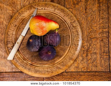 Fresh Figs And A Pear On Bread Board