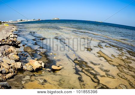 Fisheye View Of A Greek Island With  Geological Features At The Beach
