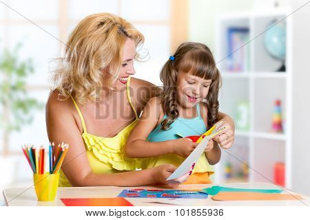 mother and daughter play doing handcraft