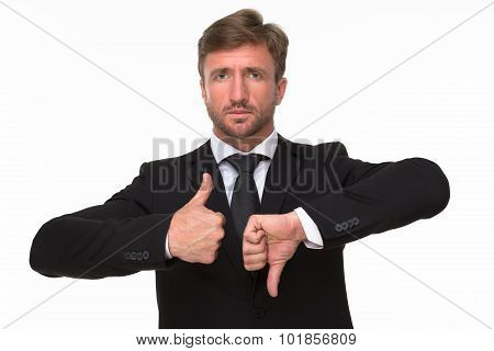 Businessman' hands giving a thumbs up and down