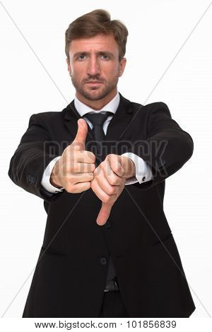 Businessman showing thumbs up and down