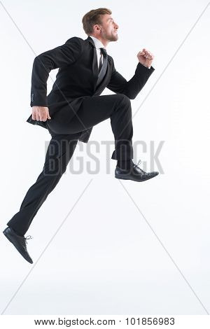 Businessman running up imaginative stairs