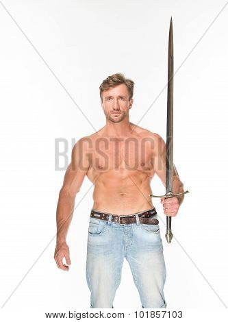 Bare-chested man with katana sword