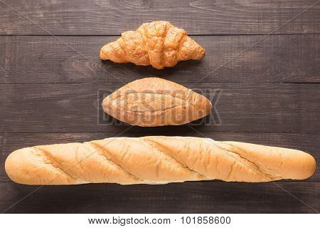 Bread Rolls On Wooden Background From Top View