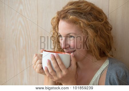 Middle-aged woman with a cup of tea