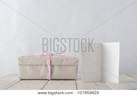 Simply Wrapped Gift Box With Icy Pink Raffia Tie And Greeting Card