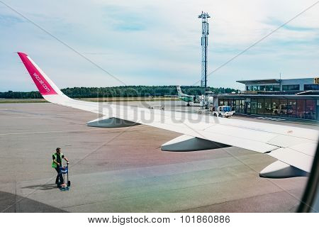 Wizzair plane at the gate, view from airplane window. Oslo, Norw