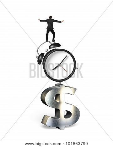 Businessman Balancing On Alarm Clock And Dollar Sign