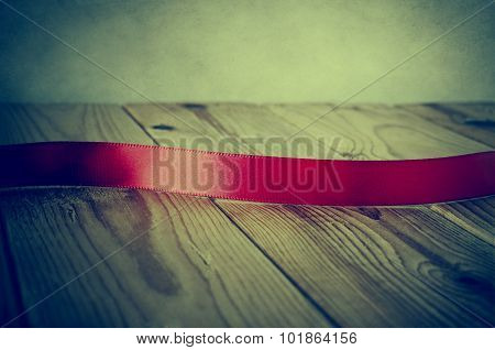 Vintage Style Red Ribbon On Wood - Cross Processed