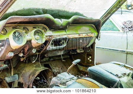 Old Interior Of Wrecked Green Car