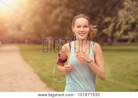 Pretty Woman Jogging At The Park With Headphones