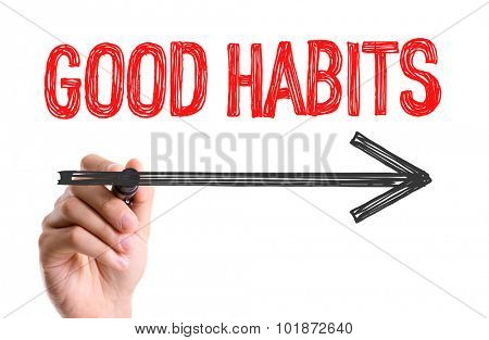 Hand with marker writing: Good Habits