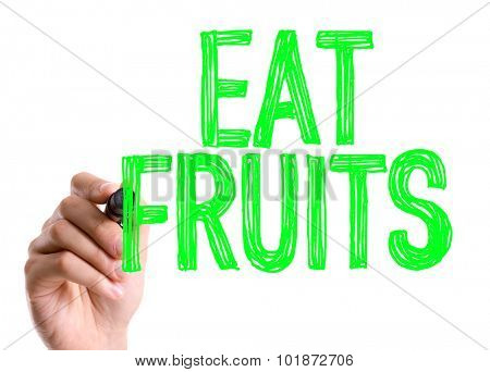 Hand with marker writing: Eat Fruits