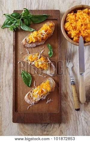 Bread Topped With Carrots And Grated Cheese
