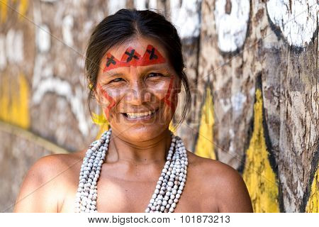 Native Brazilian woman smiling at an indigenous tribe in the Amazon