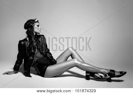 Sexy Woman Model Dressed Punk, Wet Look, Posing In The Studio