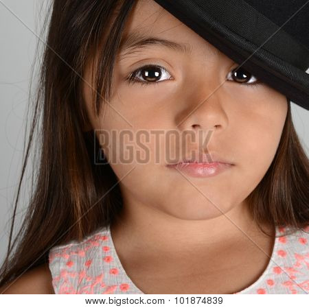 Nice Image of a young latino Actress with Bowler hat